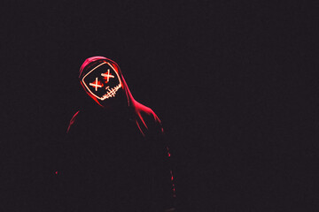 A Man Wearing A Red Hoodie With Red Glowing Mask In The Dark Backgroun