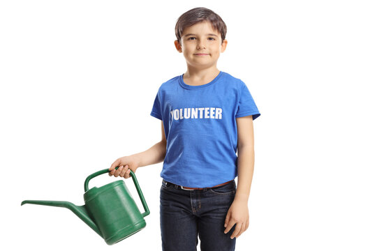 Boy volunteer in a blue t-shirt with a watering can