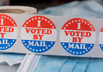 I Voted by Mail sticker on protective face mask for absentee ballot or mail-in voting in the...