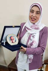 Egyptian novel writer Rania Laboudy poses for a photograph after receiving prize of late novelist Khairy Shalabi at Battana publishing house in Cairo