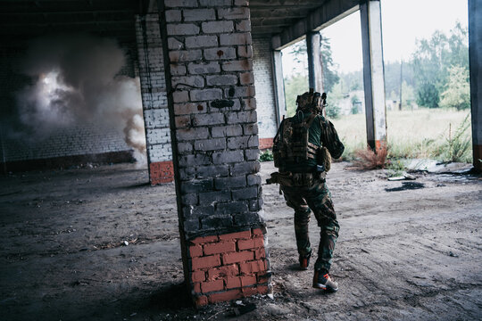 Soldier in combat. Urban combat training, soldier entering abandoned building. Anti terrorist operation battlefield training.