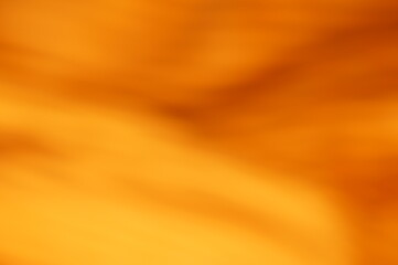 Abstract graphic background with dominant orange, gold and brown colors