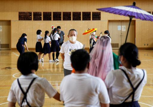 Kanjuro Kiritake, a Bunraku puppeteer, gives lessons in traditional puppet drama to students, amid the coronavirus disease (COVID-19) outbreak, at Kozu elementary school in Osaka