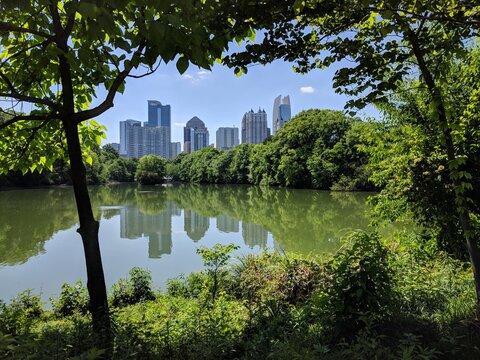 Atlanta skyline from across the lake in Piedmont Park, Georgia, USA