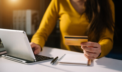 businesswoman hand using smart phone, tablet payments and holding credit card online shopping, omni...