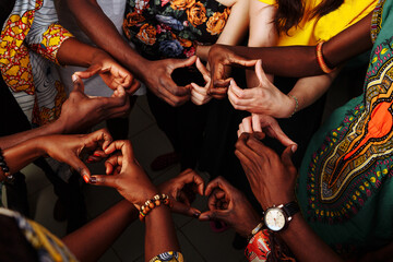 Hands make symbol of heart. Happy group of multinational African, latin american and european people which stay together in circle