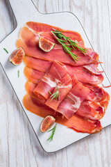 Delicious Serrano ham with fresh figs and rosemary