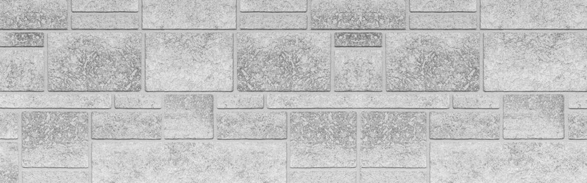 Panorama of Block pattern of white stone cladding wall tile texture and seamless background