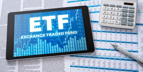 A tablet with financial documents - ETF