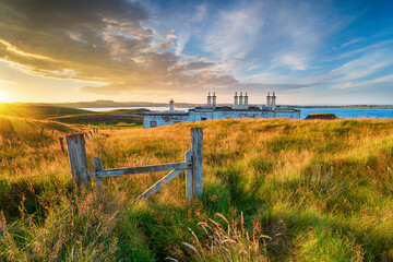 Wall Mural - Sunset over the old coastguard cottages at Arnish Point