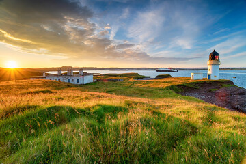 Wall Mural - Stunning sunset over Arnish Point and it's lighthouse overlooking Stornoway harbour