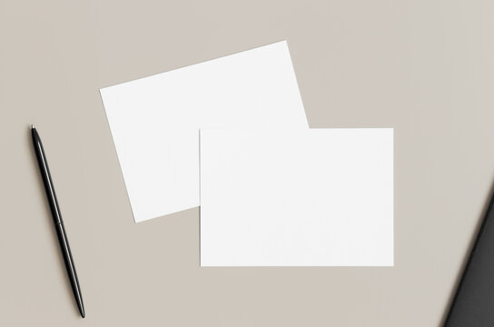 Two white invitation cards mockup, 5x7 ratio, similar to A6, A5. Workspace concept.