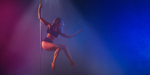 Pole dance woman on a dark, colorful background