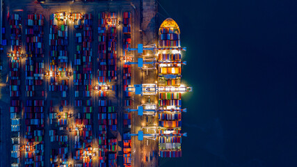 Aerial view container ship at night, import export commerce global business trade logistic and...