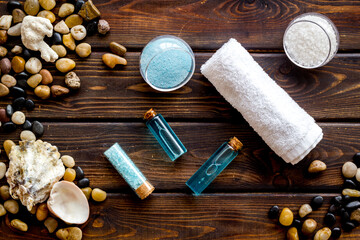 Spa set bar of sea cosmetics - aroma oil and blue salt. Above view