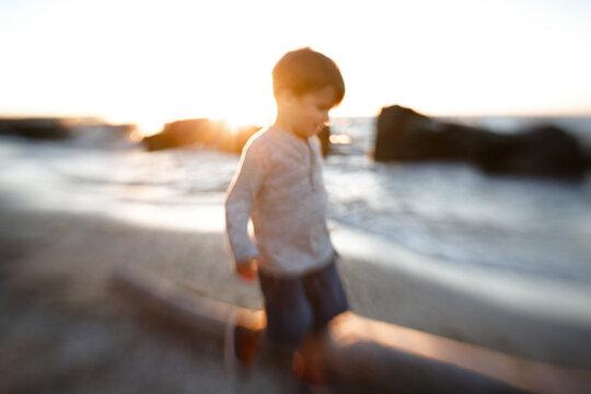 blurred photo of child at beach