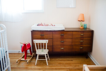 photo of baby on changing pad on dresser