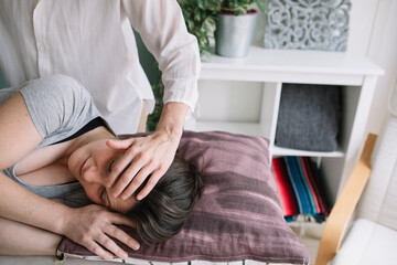 Professional Osteopath Working With Relaxed Caucasian Woman