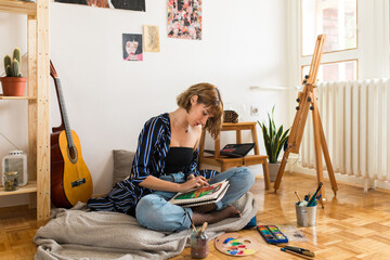 Young girl painter at home
