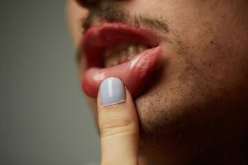 Finger touching lips