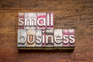 small business word abstract in gritty vintage letterpress metal types against rustic weathered wood