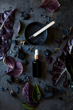 Charcoal Skin care Products and Bottle of Skin Care Oil