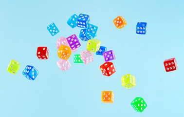 Dice in Air Against Blue Background