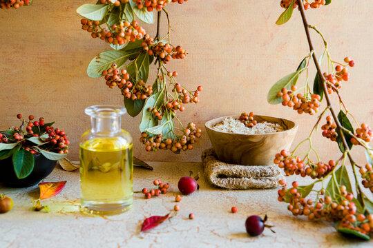 Organic Bath Salts in a wooden bowl on a hemp cloth and bath oil