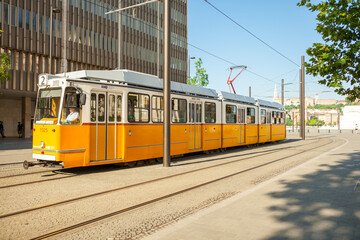 BUDAPEST, HUNGARY - JUNE 16, 2016: Tram #2 approaching to Kossuth Lajos ter stop next to the National Parliament Building, Budapest - Hungary - June 16, 2016
