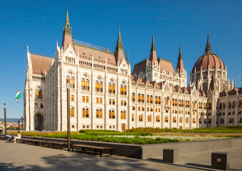 BUDAPEST, HUNGARY - JUNE 16, 2016: Hungarian Parliament building located at the bank of the Dunabe connecting Buda and Pest in Budapest, Hungary - June 16, 2016
