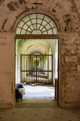 Internal spaces into the abandoned insane asylum in Naples, Italy.