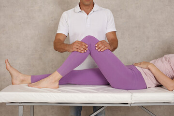 Therapist performing mobilisations on the patella, knee joint and surrounding connective tissue.