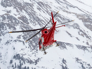 Wall Murals Helicopter Alpine rescue helicopter in winter