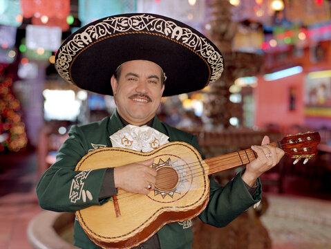 Hispanic mariachi musician playing guitar