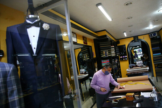 A tailor makes a mold for a dress suit at Santana tailor shop, as the coronavirus disease (COVID-19) outbreak continues in Mexico City