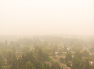 Beaverton Oregon city in smoke, behind burning forests, top view, news