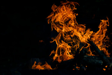 Photo sur Aluminium Texture de bois de chauffage Flame fire on black background. Fire creates infinity shapes when it burns. The orange from the flame and the black backgroud creates interesting textures. Flames from hell. Burning power.
