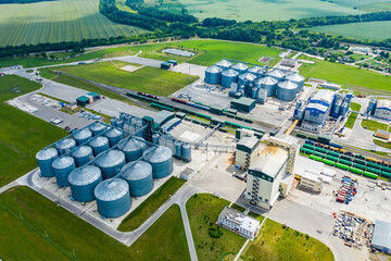 Production of sustainable fuel called bio gas. New factory in field. View from above. Ecological production.