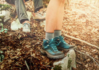 Close up of women legs wearing hiking boots