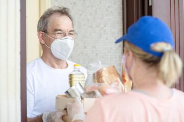 Delivering food to senior man during quarantine Coronavirus (Covid-19) epidemic