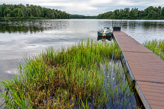 boat on Lake Jean at Ricketts Glen State Park in Pennsylvania with a dock and water grasses