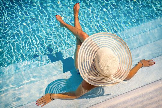 woman in luxury spa resort near the swimming pool.