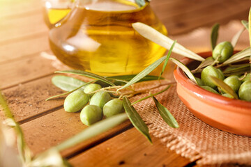 Olives freshly picked on a wooden table with oil detail