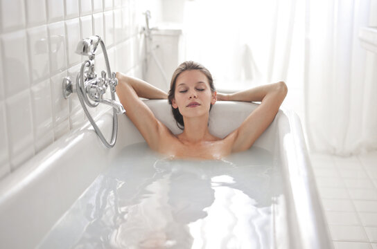beautiful relaxed woman in bathtub