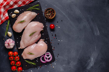 Raw chicken fillet with spices and herbs.