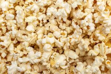 Popcorn background. Scattered popcorn. Close up. Abstract background.