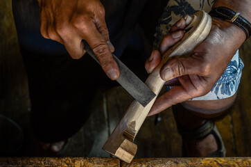 Violin maker luthier hand working a new violin scroll in Cremona Italy