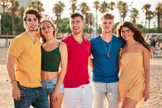 group of young and handsome people at the beach in a summer day