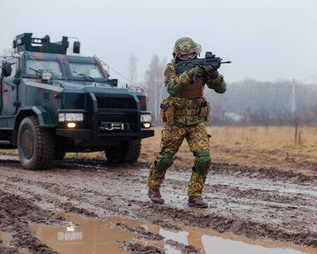 soldier patrolling with a machine gun
