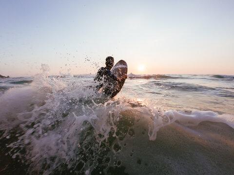 Boy surfing on the ocean
